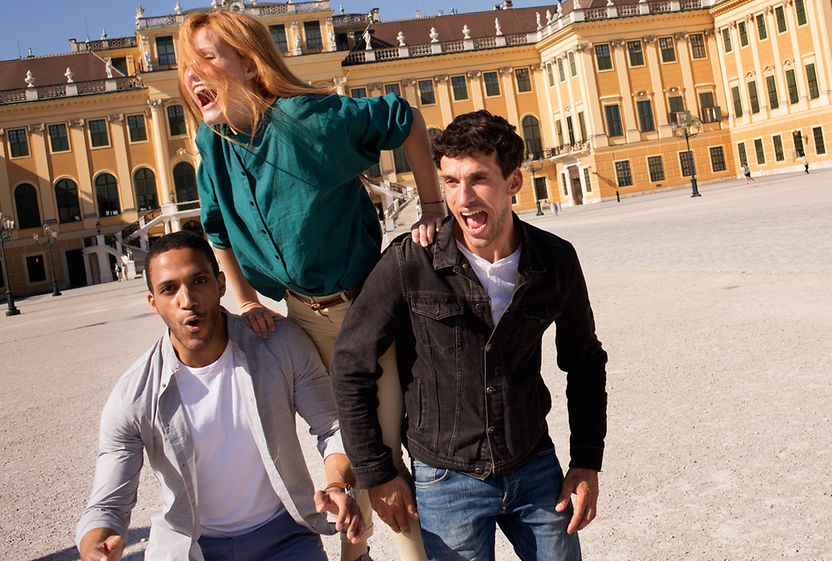 Laughing, young people in front of Schönbrunn Palace