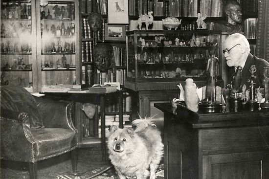 Sigmund Freud in his study with chow, 1937