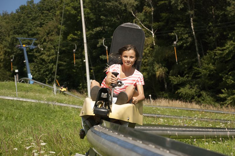 Girl speeding down the toboggan