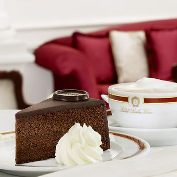 A slice of Sacher-Torte with whipped cream