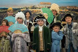 Children's museum Schönbrunn Palace, children in old costumes wearing whigs
