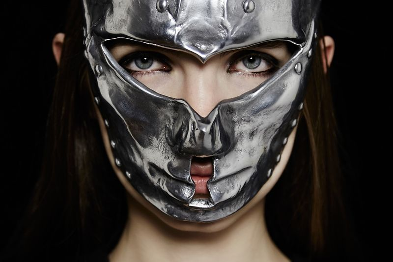 Woman wearing a mask in silver by AND_i