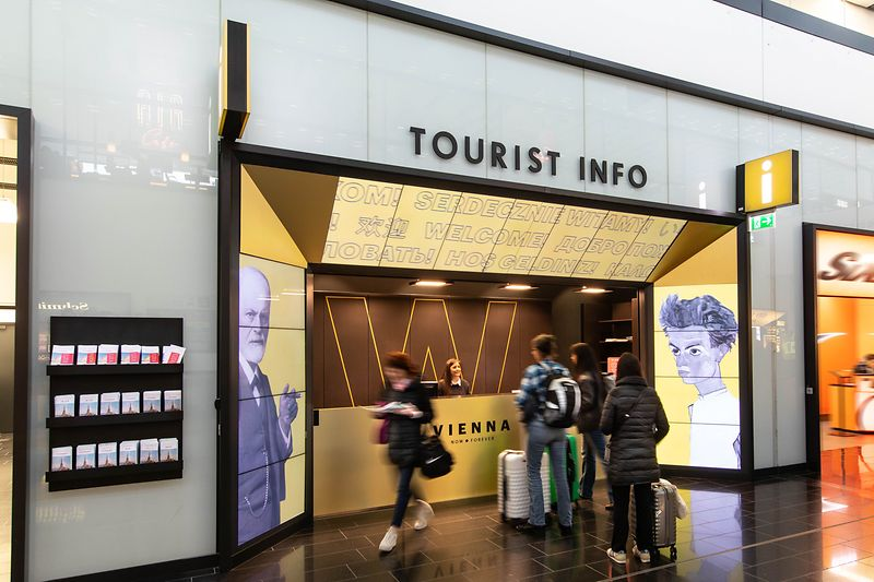 Tourist Info Vienna Airport with travelers asking for information