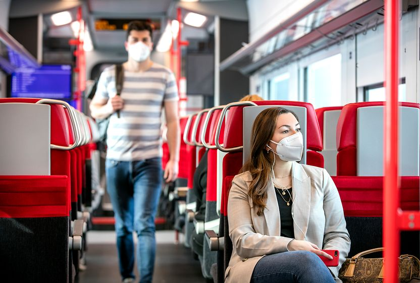 Passengers with FFP2 mask in the train